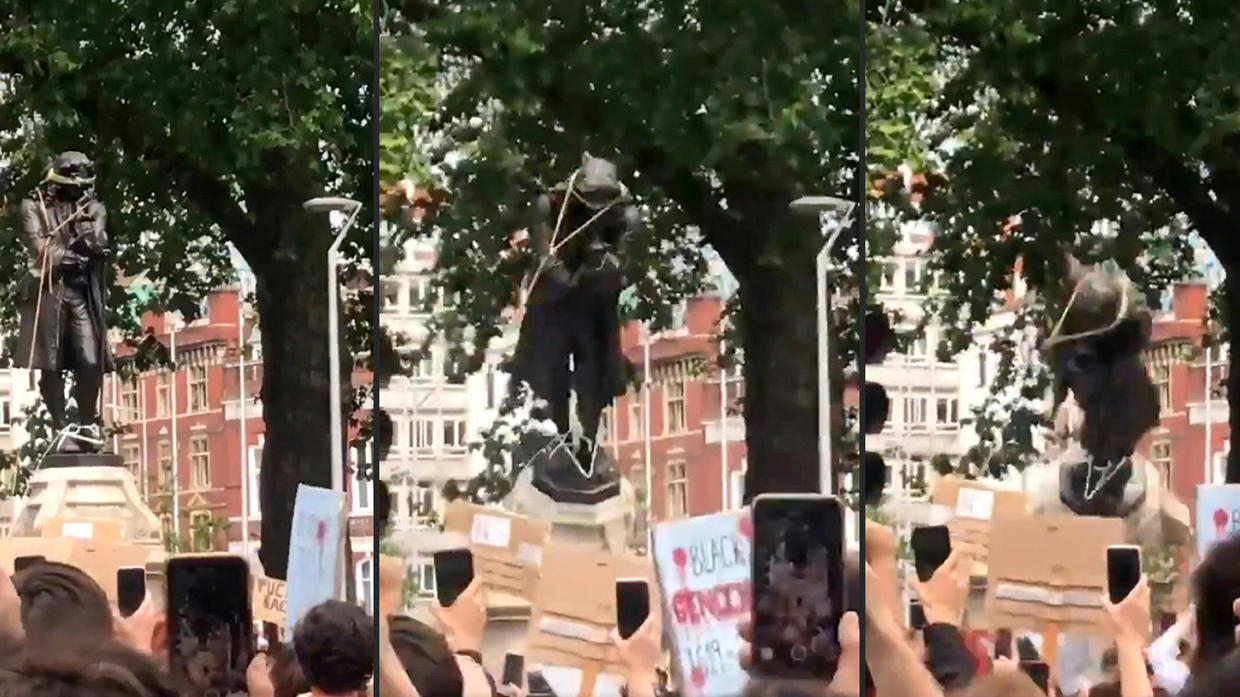 Photo of Black Lives Matter protesters topple statue of British slave trader in Bristol