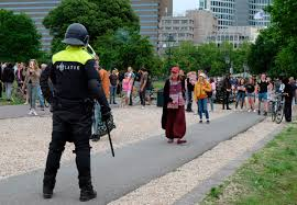 Photo of Dutch police use water cannon to disperse The Hague protest