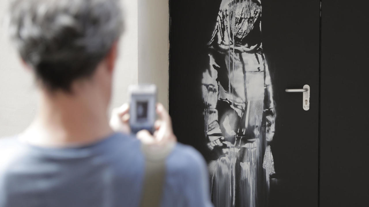 Photo of Banksy artwork stolen from Pariss Bataclan concert hall found in Italy