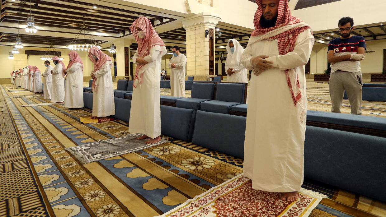 Photo of Masks, personal mats and no ablutions as Saudis reopen mosques