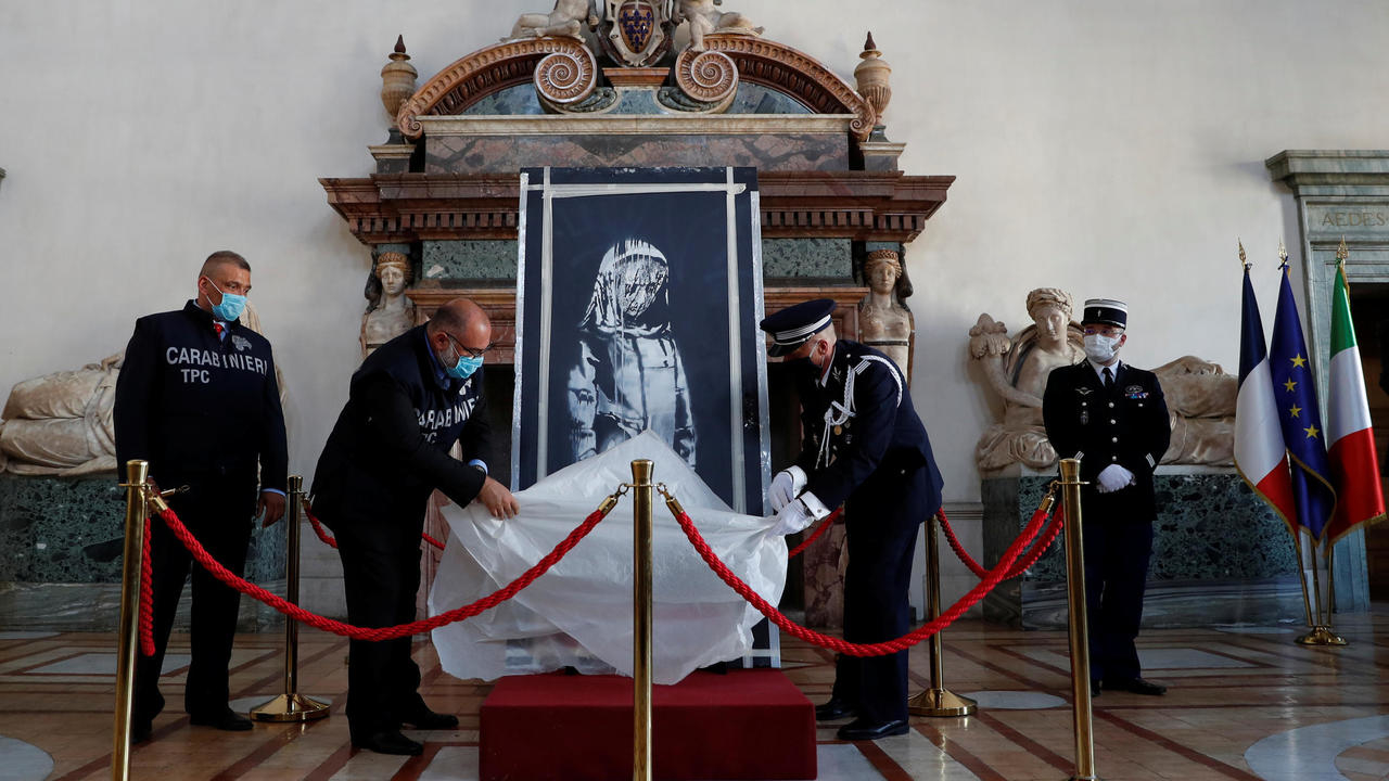 Photo of Italy returns stolen Banksy tribute to victims of 2015 Paris attacks to France on Bastille Day