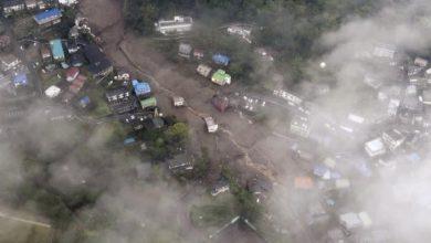 Photo of Japan rescue teams look for at least 20 missing in landslide